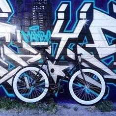 A Pure Fix Mike with pursuit bars against an art wall. #bike #bicycle #fixie #fixedgear #art #streetart #graffiti