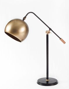 With its mix of materials including brass and steel and its impeccable design, the Bell table lamp is a room-defining piece. Available locally at Treeforms Furniture Gallery.