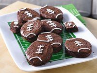 Touchdown brownies. I used my easter egg cookie cutter and i was able to get 8 footballs from a 9x13 pan