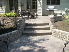 Stamped concrete patio with steps and retaining wall - Ashler slate pattern