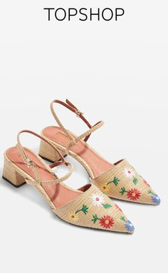 Natural raffia sandal style shoes with pretty multi-coloured embroidery.