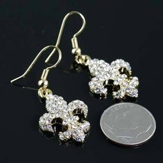NEW!  FLEUR DE LIS  RHINESTONE EARRINGS WOULD  LOOK GREAT WITH YOUR OUTFIT.  REALLY CUTE!!
