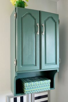 When I needed storage for our bathroom makeover, I found a way to paint an old laminate cabinet to make it fit the design. [media_id:1129944] Yes, you CAN paint…