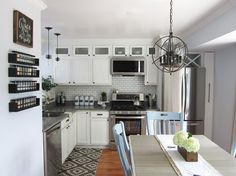 How to Give Your Builder Grade Kitchen a Makeover (on a Budget!)  small cabinets over regular cabinets, slide out pantry tp right of fridge- fabulous!