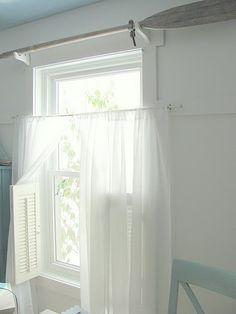 Oar for a curtain rod. How cute.