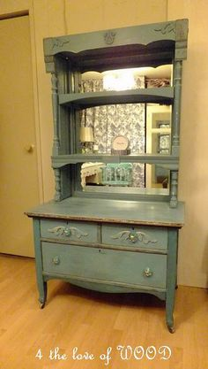 turquoise dresser with mirrored shelves