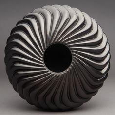 Rare and Superb Santa Clara Black 32-Rib S-Swirl Jar by Nancy Youngblood. More important Native American pottery on CuratorsEye.com