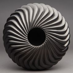 Rare and Superb Santa Clara Black 32-Rib S-Swirl Jar by Nancy Youngblood. More important Native American pottery on CuratorsEye.com