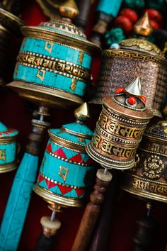 Prayer wheels with Om Mani Padme Hum inscription, a Tibetan Buddhist prayer, for sale in Thamel, a popular tourist destination in Kathmandu, Nepal.
