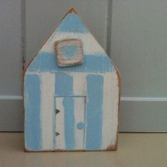 Wooden Beach Huts ... Use as stool tops