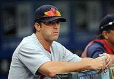 Mike Matheny looks on from the dugout against the Kansas City Royals  6-23-12