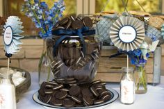 Cookies & Milk (Simply So Good): This wedding reception is such a great idea that would also make an adorable baby shower or first birthday party theme. Lots of great ideas: Displaying cookies in jars, platters, plates, baskets, etc.; offering strawberry / chocolate / white milk; putting sugar in antique milk bottles to hold cute signs (and look like milk); cookie favors; and more!