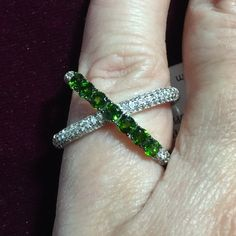 Can you say Wow... Chrome Diopside & White Zircon I love love this piece. Looks so Incredible. The Exquisite Cross Over Design is so Fashionable & Artsy. This .90ctw of Rare Russian Chrome Diopside along with Dazzling all Natural .65ctw of White Zircon. This Beauty is set in  Sterling Silver. Just stunning ....1 source gem.. Non size able   Rare Chrome Dreams Jewelry Rings