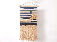 Special handwoven wall hanging, which gives a unique feel to your home walls.  SPECIFICATION:  Wooden Dowel Width: 19 Waeave at its widest: 16 Wall Hanging length: 34 Length including hanging string: 37  - Fabric: wool joot - Color: Blue, Beige and orange - Design: Geometric, Moroccan - Handmade, Handwoven    CARE INSTRUCTION: - Remove Spots Immediately, Use wet Clean Cloth. - Washer Cleaning Occasionally, as it will lower the life span of rug.  SHIPPING: All the goods are dispatched in 1-2…