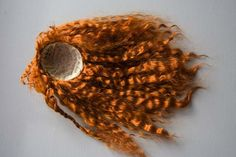 AWESOME tutorial using mohair yarn to make a doll wig. Great pictures too.