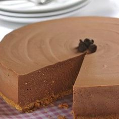 This elegant no-bake cheesecake will take pride of place on any dessert table. A base of gelatin and cream cheese makes the perfect setting for chocolate chips and whipped cream topping. Print Easy No-Bake Chocolate Cheesecake Ingredients CRUST: 1 1/4 cups graham cracker crumbs 1/3 cup butter or margarine melted 2 teaspoons granulated …