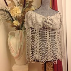 NEW ❤️UNIQUE PONCHO ❤️ Light weight yarn. Soft. Drapes over shoulders. Flower can be worn to the side or center. String can be pulled to make it as close to your neckline as possible or simply loosen it up and wear it off the shoulders. Flower has bling in the center, beads at the end of string. Dress up any outfit or use it as casual wear...very versatile piece. Handmade. This one is a light gray, but I can make others in other colors. The stitching will be slightly different to keep them…