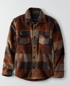 This pre-shrunk flannel shirt features a spread collar, a ...