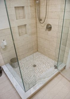 Frameless shower highlights beautiful tile work. Marble base is classic.