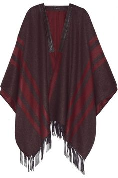 Etro's fringed cape is a key piece for tapping into the season's sophisticated '70s-inspired look. Crafted in Italy from impeccably soft cashmere, it's trimmed with a braided leather collar so it stays in place. Wear yours belted at the waist over a chambray shirt and flared pants. Get the look at NET-A-PORTER