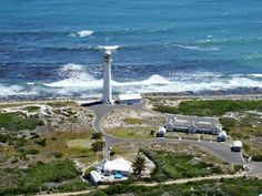 GO ON A GUIDED TOUR OF THE SLANGKOPPUNT LIGHTHOUSE  Cost: R16 for a guided tour The bright white Slangkoppunt (Snake Head Point) Lighthouse, situated on the coast in the South Peninsula, is the tallest cast iron lighthouse in South Africa.  #lovecapetown #capetown