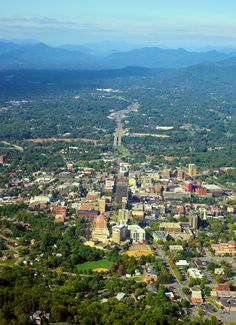 You don't see this view of AVL often: Downtown #Asheville from the air, surrounded by the Blue Ridge Mtns