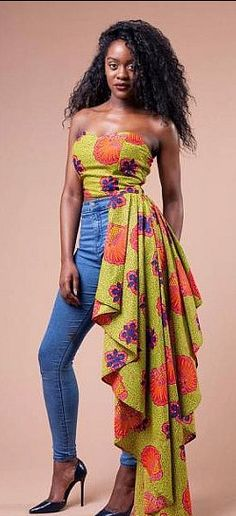 Strapless Fish Tail Peplum Blouse. A strapless blouse with fish tail peplum, made from Ankara print fabric. It fastens at the back with a zipper, made from 100% African print cotton.