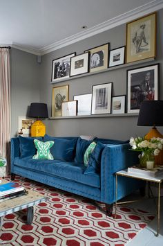 Cosy couch corner. Love the pictures stacked, and the castors on the coffee table. - desiretoinspire.net