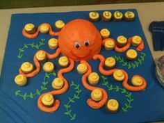Even better than having the cupcakes form the arms. So many wonderful ideas!