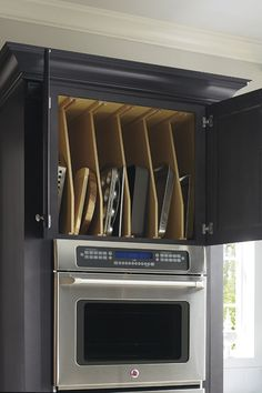 Above the oven is the perfect place to store serving ware, party trays, or bakeware in an organized, easy to access when needed fashion.