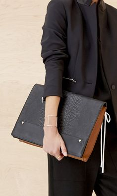 Oversize colorblocked clutch with a structured shape and faux snake-embossed foldover