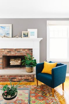 Cohesive Decor and Originality in a Boston Family Home - Jessica gave this blue Ikea chair new legs from Pretty Pegs. - @Homepolish Boston