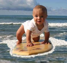 baby boy surfing, a perfect age to start & get comfortable on a board and in the water!