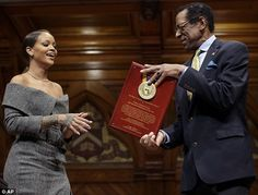 Good works: Rihanna, 29, was named the Humanitarian of the Year by Harvard University on Monday; She is seen with Allen Counter, the director of the Harvard Foundation