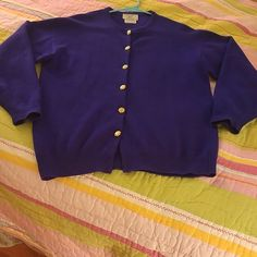 Cashmere Cardigan 100% cashmere cardigan from McCulley's of Scotland.   Very good condition with no holes, picks or pilling, but it is missing the Bottom gold button.   This is hand washable and although i see no size tag, this beautiful sweater fits like a large.  It is arguably either royal blue or purple. McCulley's Sweaters Cardigans