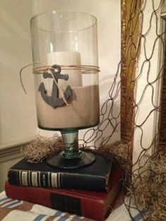 Vase filled with sand and candle, anchor tied around it