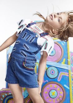 Find denim dungarees with embroidered zig zags in the Stella McCartney Kids #SS16 collection.