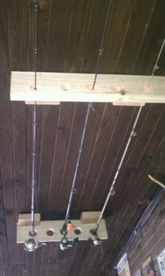 Fishing pole ceiling holder out of scrap wood.