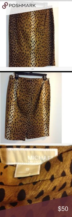 MICHAEL KORS Leopard Print Pencil Skirt. NWOT This is a gorgeous skirt. It had never been worn, only looked at. Leopard Print/Pencil/Wiggle skirt. Knee length, great stretch, flattering darts in front and back. It has a back zipper, 97% Cotton and3%Spandex. Michael Kors Skirts Midi