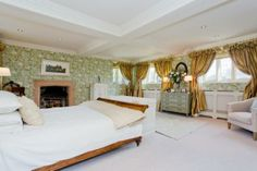 Spacious bedroom at Ackworth Old Hall, with lots of big windows to let natural light in.