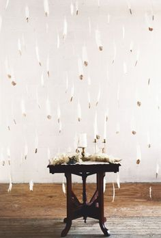 Hanging Feather Wall | photography by http://www.leighanneherr.com/