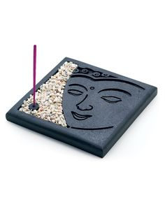 The face of the meditating Buddha- commonly believed to bring peace and serenity- appears on the platform of this personal incense holder. Comes complete with small stones for laying a bed around the burning incense sticks (10 included).