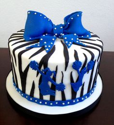 Fondant silver studded blue zebra and cheer cake. Our marshmallow fondant is now available on our Etsy!  https://www.etsy.com/listing/208545746/homemade-marshmallow-fondant-2-pounds