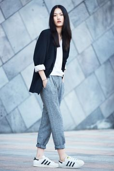 black blazer, white top, slouchy grey cuffed pants & Adidas sneakers #style…