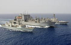 Canadian HMS Toronto, left, and the USS Stockdale, right, are attached to the American ship Cesar Chavez for a replenishment at sea in the Gulf of Oman August 16, 2013 as part of Operation Artemis . Toronto is deployed in the Arabian Sea since January 2013 within the Combined Task Force 150 and is involved in maritime security missions and fight against terrorism in the region.