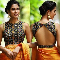 Triangle Cut Out Back Blouse Design! we've fetched more than 200 blouse designs that you'll go gaga over. Be it for a simple saree, bridesmaid lehenga or a bridal lehenga, these blouse designs are the perfect inspiration you need. Blouse Back Neck Designs, Stylish Blouse Design, Fancy Blouse Designs, Brocade Blouse Designs, Indian Blouse Designs, Cotton Saree Blouse Designs, Blouse Designs Wedding, Latest Saree Blouse Designs, Traditional Blouse Designs