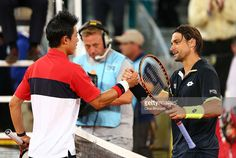 Kei Nishikori of Japan shakes hands at the net after his straight sets victory against David Ferrer of Spain in their quarter final match during day seven of the Mutua Madrid Open tennis tournament at the Caja Magica on May 8, 2015 in Madrid, Spain.