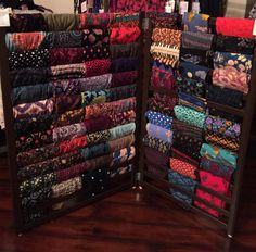 Lularoe Leggings Display. You just need crib rails!!! Remove hardware and extra trim boards, paint. Add hinges and some slides for feet and its ready to load with your leggings! Message me if you have questions!