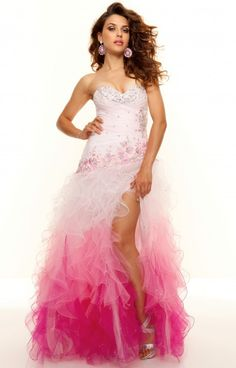 You'll catch everyone's eye at your prom or pageant thanks to the gorgeous embroidery and beading on the ruffled tulle of the Paparazzi 93044. The sweetheart neckline and ruching of this figure flattering bodice is detailed with rhinestones.  This trendy gown features a front slit in the ombre tulle skirt that will show off your legs and fabulous new heels at your next event!