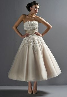 Wedding designer known for vintage wedding dresses and bridal couture styling. Every bridal gown is a masterpiece. Find your dream bridal dress. See More: Justin Alexander Bridal Delicate Wedding Dress, Tea Length Wedding Dress, Tea Length Dresses, Bridal Wedding Dresses, Wedding Dress Styles, Tulle Wedding, 50s Wedding, Ivory Wedding, Short Dresses